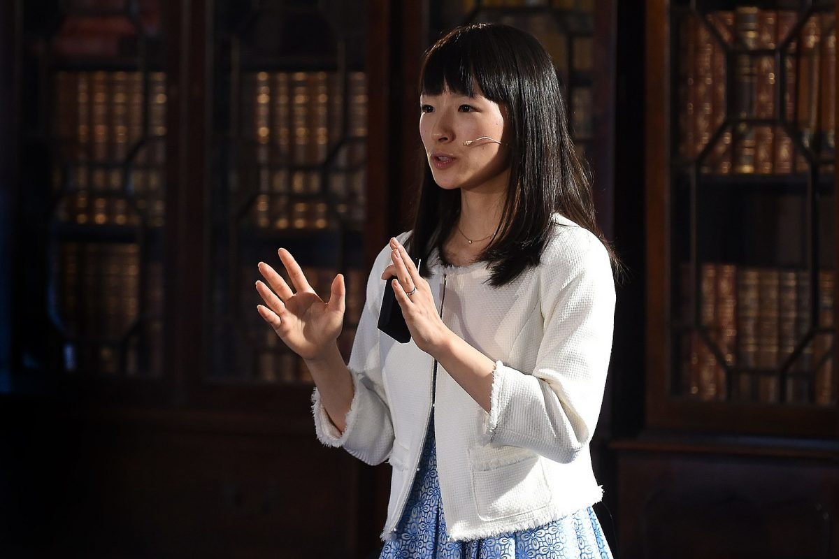 """Marie Kondo is notorious for her """"KonMari"""" method, which starts with committing to tidying up and ends with asking yourself what sparks joy. [Credit: Diarmuid Greene // Wikimedia Commons]"""