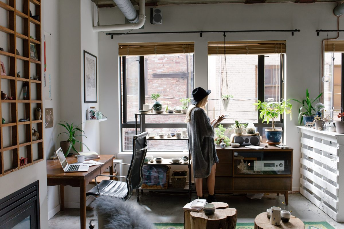 Opting for a smaller space just to get a better sense of the buying and selling processes of a home is something young women may want to consider. [Credit: Bench Accounting // Unsplash]